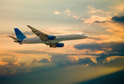 Airplane and beautiful sunset. Adobe RGB.