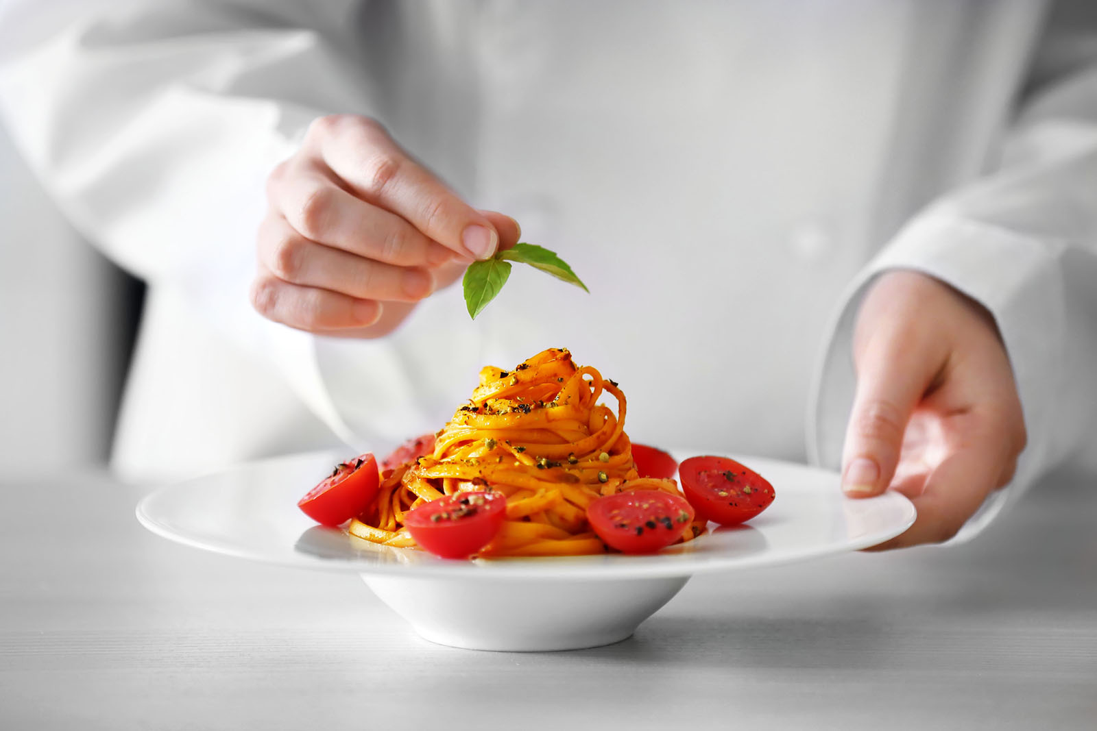 Chef hands preparing delicious cold pasta salad on the table closeup; Shutterstock ID 411058705