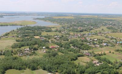 поля земля поселок дома